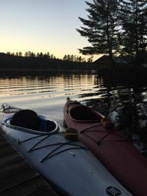 Kayaks await an evening paddle